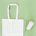 Eco paper bag flat lay on green background - PhotoDune Item for Sale