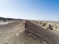 Woman trail runner looking at the view in desert - PhotoDune Item for Sale