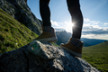 Successful woman backpacker hiking on sunset alpine mountain peak - PhotoDune Item for Sale