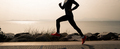 Fitness woman running on winter coast - PhotoDune Item for Sale
