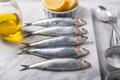 Fresh sardines and lemon on the stone marble background - PhotoDune Item for Sale