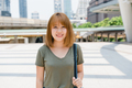 Attractive young smiling Asian woman outdoors portrait in the city real people series. - PhotoDune Item for Sale