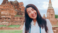 Asian backpacker blogger woman casual with camera take photo smiling traveling around pagoda. - PhotoDune Item for Sale