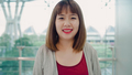 Portrait of cheerful casual happy young Asian woman in international airport smiling to camera. - PhotoDune Item for Sale