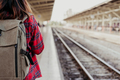 Young Asian woman backpacker traveler walking alone at train station platform with backpack. - PhotoDune Item for Sale