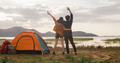 Young asia campers couple run and raised arms at campsite near beach. - PhotoDune Item for Sale