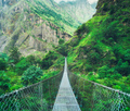Suspension metal bridge and beautiful green forest in mountains - PhotoDune Item for Sale