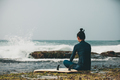 Woman surfer sit on reef looking at the waves - PhotoDune Item for Sale