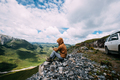 Successful woman hiker using smart phone on alpine mountain top - PhotoDune Item for Sale