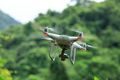 White drone with camera flying in summer mountains - PhotoDune Item for Sale