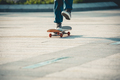 SkateboardingSkateboarder riding on skateboard outdoors in city - PhotoDune Item for Sale