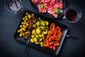 Assortment of appetizers and tapas with red wine on black background - PhotoDune Item for Sale