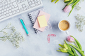 Workplace with cup of coffee, empty notebook, keyboard, supplies and flowers - PhotoDune Item for Sale