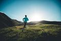Young woman ultramarathon runner running at mountain top - PhotoDune Item for Sale