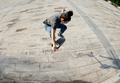 Asian woman skateboarder skateboarding in modern city - PhotoDune Item for Sale