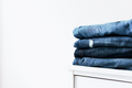 Stack of different jeans on the shelf or table - PhotoDune Item for Sale