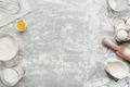 Baking concept flat lay. Ingredients, kitchen utensils, grey concrete background - PhotoDune Item for Sale