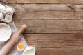 Baking concept flat lay. Ingredients, kitchen utensils, wooden background - PhotoDune Item for Sale