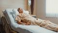 Sad senior Asian man having having heart attack lying on hospital bed and press emergency button. - PhotoDune Item for Sale