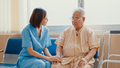 Young Asian woman nurse caregiver encourage take care her senior patient hold hand explain. - PhotoDune Item for Sale