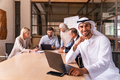 Multiethnic business team meeting in the office - PhotoDune Item for Sale
