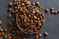 Arabica beans in bowl on grey - PhotoDune Item for Sale