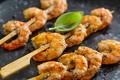 Shrimp skewers on dark plate - PhotoDune Item for Sale