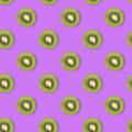 Creative seamless pattern made of kiwi, purple background. Food concept - PhotoDune Item for Sale