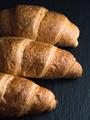 Fresh croissants on black slate background - PhotoDune Item for Sale