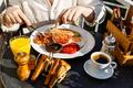 Man eating Full fry up English breakfast on sunny summer morning - PhotoDune Item for Sale