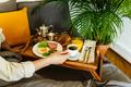 Breakfast in bed on table tray, male hand holding coffee - PhotoDune Item for Sale