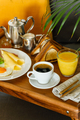 Breakfast in bed with coffee, fried eggs and ham on table tray close-up - PhotoDune Item for Sale