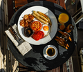 Full fry up English breakfast served on round table on sunny summer morning - PhotoDune Item for Sale