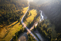 Aerial view of mountain road and beautiful forest at sunset - PhotoDune Item for Sale