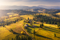 Aerial view of beautiful village in mountains at sunset - PhotoDune Item for Sale
