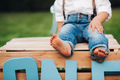 Little boy sitting on a wooden box - PhotoDune Item for Sale