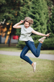 Happy caucasian woman dances and jumps in the summer park - PhotoDune Item for Sale