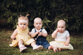 Cute kids sitting on the grass in the park - PhotoDune Item for Sale