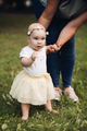 Picture of beautiful little baby goes for a walk in the park with her mother and she is interested - PhotoDune Item for Sale