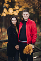 Couple in love goes for a walk in the autumn park together - PhotoDune Item for Sale