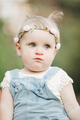 Cute little baby with beautiful bandage posing outdoors - PhotoDune Item for Sale