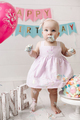 Cute little baby girl wearing pink dress get dirty in cake cream celebrating holiday - PhotoDune Item for Sale