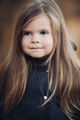 Portrait of cute little girl with long hair and hazel eyes medium close up - PhotoDune Item for Sale