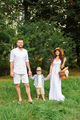 Happy young family walking in the park - PhotoDune Item for Sale