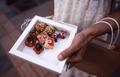 woman holding a box of Turkish delights deserts on the street - PhotoDune Item for Sale