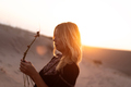 portrait of young blonde woman at sunset in sand dune - PhotoDune Item for Sale