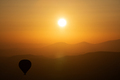 hot air balloon silhouette with sun rising over the mountains - PhotoDune Item for Sale