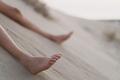 resting child feet in sand dune - PhotoDune Item for Sale