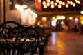 black chairs with tables on terrace on a illuminated street - PhotoDune Item for Sale