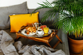 Breakfast in bed with croissants and coffee in bed on table tray - PhotoDune Item for Sale